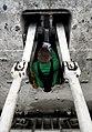 US Navy 090407-N-6538W-025 Aviation Boatswain's Mate Airman Oscar Auten, from Council Bluffs, Iowa, wipes down the hydraulic piston of a jet-blast deflector on the flight deck of the Nimitz-class aircraft carrier USS John C. St.jpg