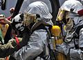 US Navy 090428-N-2638R-001 Ship's Serviceman Seaman Johnnie Jackson and Damage Controlman Fireman Terrel Rowan, both from Houston, wear hot suits as they assist the pilot of an SH-60B Sea Hawk.jpg