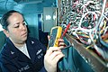 US Navy 091004-N-8960W-014 Interior Communications Electrician 3rd Class Karla Martinez inspects wiring aboard the aircraft carrier USS Nimitz (CVN 68).jpg