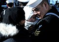 US Navy 091222-N-6764G-076 Damage Controlman 1st Class Lawrence Madrid is reunited with his wife after returning from a three month deployment.jpg