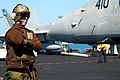 US Navy 100116-N-3589B-116 Aviation Boatswain's Mate (Equipment) Airman Brandon Young conducts pre-flight checkups on an F-A-18C Hornet assigned to the Sidewinders.jpg
