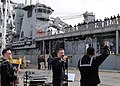 US Navy 100222-N-6676S-140 The Commander, U.S. Naval Forces Europe rock band, The Flagship, perform for the crew of the amphibious dock landing ship USS Gunston Hall (LSD 44) as the ship arrives at Naval Station Rota for a port.jpg