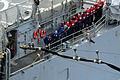 US Navy 100304-N-0808V-148 Sailors aboard the Ticonderoga-class cruiser USS Bunker Hill (CG 52) heave a line during a replenishment at sea with the aircraft carrier USS Carl Vinson (CVN 70).jpg