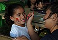 US Navy 100507-N-6046S-070 Children enjoy a free concert and face painting during a free Morale Warfare and Recreation sponsored concert at Naval Support Activity Mid-South.jpg