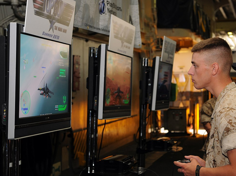 US Navy 100525-N-1831S-004 A Sailors en route to Fleet Week New York aboard the multipurpose amphibious assault ship USS Iwo Jima (LHD 7) play a demonstration copy of the new Top Gun video game
