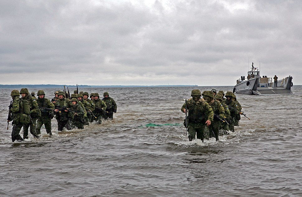 US Navy 100615-M-0884D-033 Estonian soldiers wade ashore during a combined U.S. and Estonia amphibious assault training exercise during Baltic Operations (BALTOPS) 2010