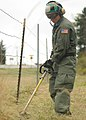 US Navy 100910-N-9520G-007 Chief Naval Air Crewman (Mechanical) (Sel.) Paul Winch uses a string trimmer to cut overgrown grass during the annual cl.jpg