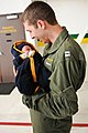 US Navy 101219-N-8590G-007 Lt. Daniel Clayton embraces his newborn son for the first time during a homecoming celebration for the Dusty Dogs of Hel.jpg