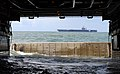 US Navy 110321-N-KB563-650 The Nimitz-class aircraft carrier USS Abraham Lincoln (CVN 72) passes by as the amphibious transport dock ship USS Cleve.jpg