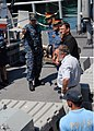 US Navy 110627-N-JL509-038 Ensign Daniel Rocha explains mine-hunting equipment to Police Senior Superintendent Virgilio C. Parrocha.jpg