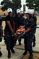 US Navy 110701-N-NR955-107 A stretcher-bearer team carries a simulated injured person to safety during a disaster training exercise at the Portugue.jpg