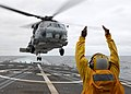 US Navy 110711-N-ZI300-135 A landing signal enlisted signals to the pilots of an SH-60B Sea Hawk helicopter taking off from the guided-missile frig.jpg