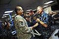US Navy 110819-N-YR391-007 MCPON Rick D. West gives his challenge coin to OS2 Rolando Albarracin.jpg