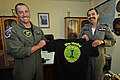 US Navy 110906-N-IZ292-276 Lt. Cmdr. Teague Suarez presents a T-shirt to Wing Cmdr. Misra Shashank during a visit to the MPF Helo Squadron.jpg