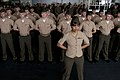 US Navy 111207-N-FH966-030 Staff Sgt. Leatha Finch stands at parade rest in front of a formation of Marines during a commemoration ceremony aboard.jpg