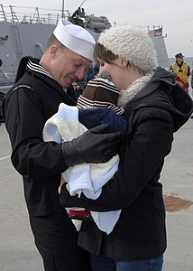 US Navy 111210-N-PI709-221 Damage Controlman 3rd class Jason DeShields hugs his wife and baby after returning to Naval Station Norfolk aboard the g.jpg