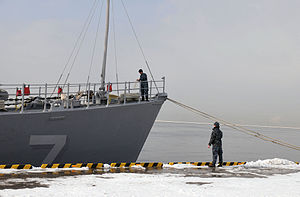 US Navy 120214-N-MU720-007 Sailors assigned to the mine countermeasure ship USS Patriot (MCM 7) work on the bow following Patriot's arrival to Hako.jpg