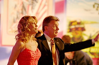 Pat Sajak and Vanna White have hosted the syndicated version since 1983. Vanna White and Pat Sajak, 2006 edit.jpg