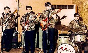 Velvet Crest - Velvet Crest, from left, Dave Bartos (vocals/bass), Joel Gordon (vocals/rhythm guitar), Terry St. George (vocals/lead guitar), Jeff Kerekes (vocals/drums), perform at a concert under their original name, By Popular Demand, c. 1968