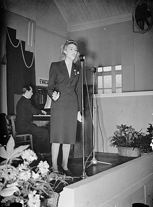 Vera Lynn - Lynn sings at a munitions factory in 1941