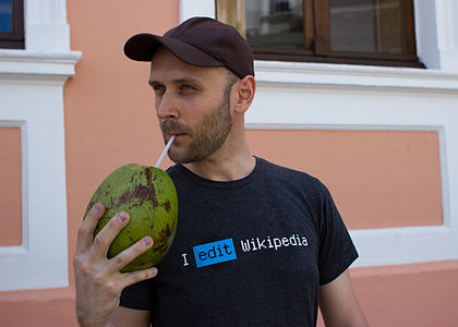 Victor Grigas drinking a coconut in Curitiba March 2012-11.jpg