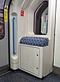 Victoria Line carriage passenger lean seat.jpg