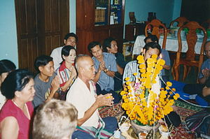 Tai folk religion - A baci rite conducted by a family in Vientiane.