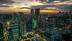 View from Grand Hyatt Manila overlooking Bonifacio Global City and Makati skylines at sunset.jpg