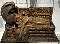 Vishnu sleeps on the coils of Ananta (the World Snake). He will awake for the next cycle of creation which heralds the destruction of all things. Sculpture. From India, c. 14th century CE. National Museum of Scotland.jpg