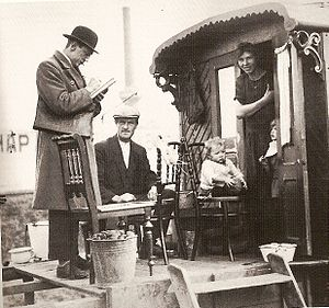 Census - Census taker visits a Romani family living in a caravan, Netherlands 1925