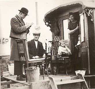 Romani people - A census taker visits the caravan of Theunisz Gieleman, and his wife Tonia Cornelia Huurman, and their two oldest children Antonia and Anne, Hemweg, Amsterdam, Netherlands, 1925