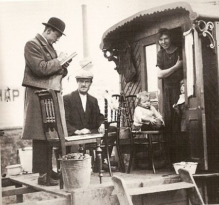 Census taker visits a family of Indigenous Dutch Travellers living in a caravan, Netherlands 1925 Volkstelling 1925 Census.jpg