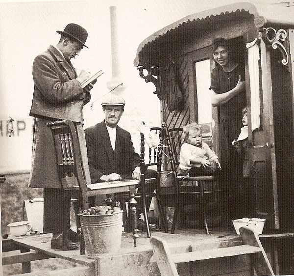 Census taker visits a family of Indigenous Dutch Travellers living in a caravan, Netherlands 1925