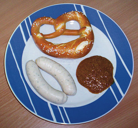 Weisswurst with sweet mustard and a pretzel