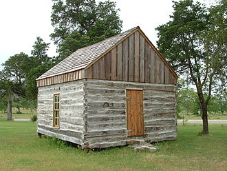 Serbin, Texas - Wendish pioneer log cabin on the grounds of St. Paul Lutheran Church. Cabin was home of John Kilian, as well as serving as school and church.