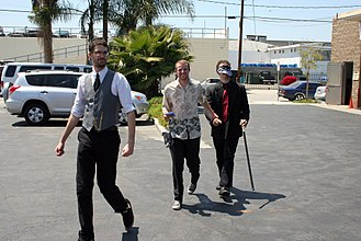 Bachelor party - A bachelor being led to his party