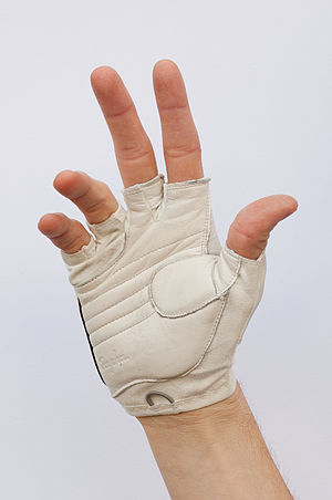 Cycling glove - A white leather fingerless cycling glove on a man's hand