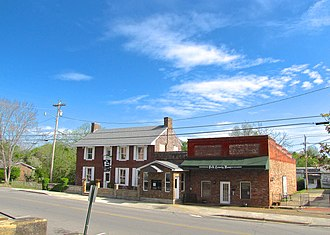 Benton, Tennessee - The Drug Store (left) and Polk County News block in Benton
