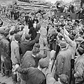 Winston Churchill is cheered by workers during a visit to bomb-damaged Plymouth, 2 May 1941. H9265.jpg
