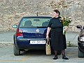 Woman with Flowers on Street - Zadar - Croatia.jpg