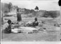 Women washing clothes in a hot pool at Whakarewarewa ATLIB 130438.png