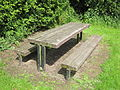 Wooden picnic table at Rivacre Country Park.jpg