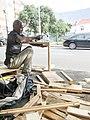 Woodworker producing a coffeebook table on Mill st by bibiloucapetown.jpg