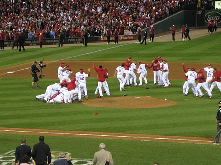 Cardinals players celebrate after winning their franchise's 11th World Series title. World Series 2011 Cardinals Victory Pile.jpg