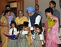 Young school children tying 'Rakhi' to the Prime Minister, Dr. Manmohan Singh, on the occasion of 'Raksha Bandhan', in New Delhi on August 05, 2009.jpg