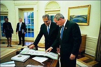 Zalmay Khalilzad - Khalilzad presenting President George W. Bush a ballot from the first democratic election in Afghanistan on October 18, 2004.