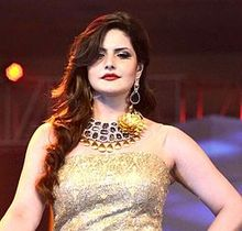 Zarine Khan looks down at the camera
