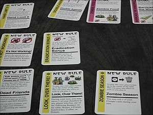 Fluxx - Zombie Fluxx cards in play, including New Rules (yellow) and Goals (pink).