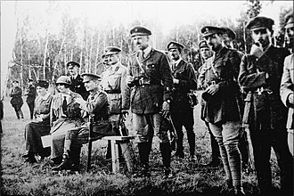 Alexander Kolchak - Kolchak (seated), Anna Timiryova and General Alfred Knox (behind Kolchak) observing military exercise, 1919