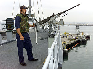 Force protection - A US Navy sailor on force protection duties aboard the USS ''Coronado'' in San Diego Harbor on 12 September 2001